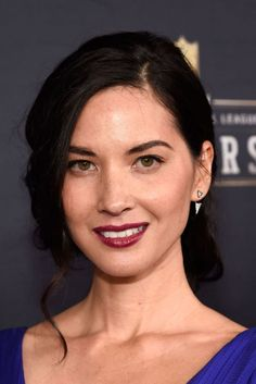 Olivia Munn's vampy oxblood lip and pinned-back Old Hollywood curls