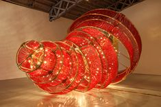 "Ai Weiwei, ""Descending Light"", 2007, glass crystal, lights, and metal; 400 x 663 x 461 cm."