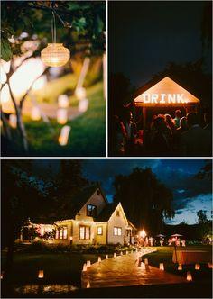 lit up wedding reception paper lanterns drink sign and strands of lights #weddingideas #weddinglighting #weddingchicks http://www.weddingchicks.com/2014/02/03/dream-moments-wedding/