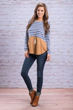 """""""Just Can't Decide Top, Blue"""" We just can't decide what part of this top we like more! The blue and ivory stripes are classic, which we love! It has adorable little going down the back! #newarrivals #shopthemint"""