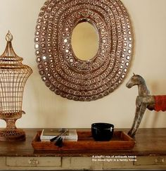 So ever since I posted about fabulous foyers the other week, I haven't been able to get this image out of my head: The GORGEOUS peacock mirror paired with the colourful ethnic cabinet just ta… Peacock Mirror, Anthropologie, Candle Holders, Candles, Architecture, Pretty, Projects, Room, Mirrors