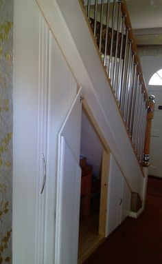 Example of angled doors installed in an under stair configuration Door Under Stairs, House Stairs, Under Stairs Cupboard, Hall Cupboard, Utility Cupboard, Replacement Wardrobe Doors, Fitted Wardrobe Doors, Stair Storage, Door Storage