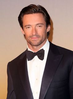 And of course Hugh looks dashing in his tux.  I sure hope I can dance in my dress!