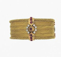 Diamonds, rubys and golden bracelet