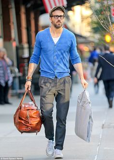 Father-to-be: The Gossip Girl's husband Ryan Reynolds - who turns 38 on October 23 - was last photographed Thursday toting luggage outside their Manhattan hotel