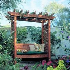 small pergola with wisteria