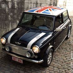 Classic Mini with Union Jack roof...A girl in Covington, Va. has a Cooper in white, with a British flag on the top...So awesome...