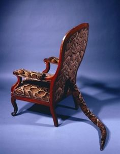 """""""Primitive Seating"""", a sculpture by Dorothea Tanning (1982); Fabric, upholstered wood chair, and wool."""