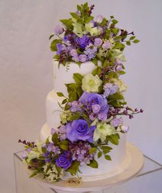Fall Wedding Cakes. Purple is the perfect color to accent a fall affair; this cake%u2014decorated with intricate sugar roses, hydrangea, stock, and cymbidium orchids%u2014is a lovely way to showcase your wedding palette. Cake by Sylvia Weinstock Cakes