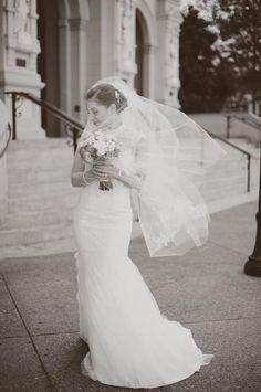 A stunning David's Bridal Bride in her Melissa Sweet Chantilly Lace wedding gown.