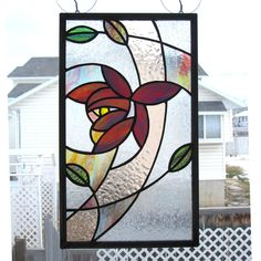 Stained Glass Panel, Stylized Floral. $70.00, via Etsy.