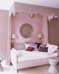 PINK FLORAL CANOPY For a young girl's bedroom, designer Katie Ridder uses a floral cotton by Muriel Brandolini for the walls, bed curtains, pillows, and fanciful canopy. ELLE DECOR