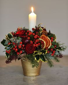 Christmas Flowers To Add To Your Wishlist This Year - HomyBuzz Christmas Flower Decorations, Christmas Flower Arrangements, Candle Arrangements, Christmas Table Centerpieces, Christmas Flowers, Christmas Candles, Christmas Wreaths, Flower Centrepieces, Christmas Berries