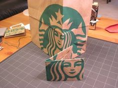 Create an origami wallet from a Starbucks paper bag. Also great for giving gift cards. Make this wallet from other paper, or tyvek!