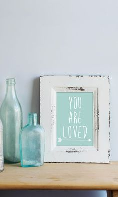 "Home decor + prints that help you decorate on a budget. This ""you are loved"" print is the perfect way to dress up any nursery, home or office!"
