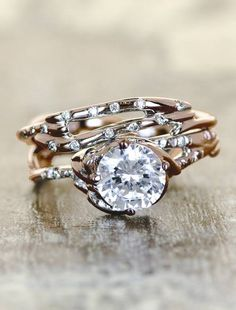 Diamond ring with scattered eternal diamonds on Rose Gold