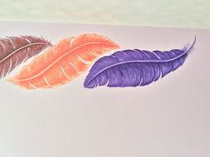 Feathers painted on a bedroom wall by Murals by Wallworx