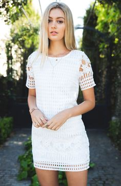 "<p><strong style=""font-family: arial, helvetica, sans-serif; font-size: small;"">Description</strong><br /><span style=""font-family: arial, helvetica, sans-serif; font-size: small;"">- Crochet Overlay Shift Dress</span><br /><span style=""font-family: arial, helvetica, sans-serif; font-size: small;"">- Sheer Sleeves</span><br /><span style=""font-famil..."