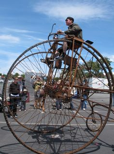 What a work of beauty! This steampunk bicycle was spotted recently by RidingPretty at the Maker Faire.    Absolutely incredible! Heh, now all it needs is some kind of balloon attachment that converts it into an air ship.