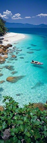 Fitzroy Island, Queensland, Australia. Fitzroy Island is a continental island out from Djujbirri, 29 km south east of Cairns, Queensland. It is a large tropical island, with a rainforest covering and its own fringe coral reef system.