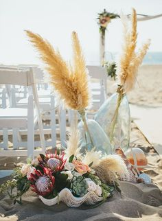 How do you feel about maybe some plumes of grasses? I love these! Could be gorg on the arbor with all of the green!