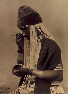 African Ornaments: This photograph was taken by Duggan-Cronin of a Sangoma from the Eastern Cape taking snuff. African Tribes, African Art, African Union, Wellcome Collection, Xhosa, Witch Doctor, Hair Decorations, Walkabout, Portraits