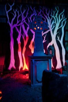 Backdrop of trees in graveyard scene from another pinners Sleepy Hollow themed Halloween party.