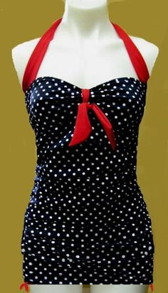Tankini. Vintage. They should have gave the manican some more curves because this one makes the dress look flat...