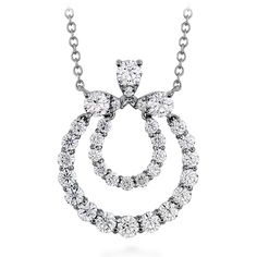 The Aerial Double Circle Necklace is a distinctive design in a timeless style