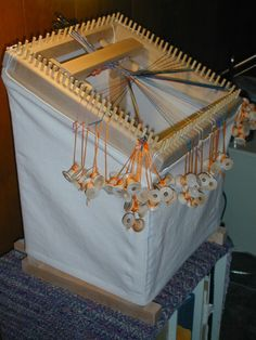 Takadai loom.  I'll make mine from old stuff, and maybe a couple of long springs from the hardware store.