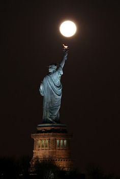 Super Moon over statue of liberty