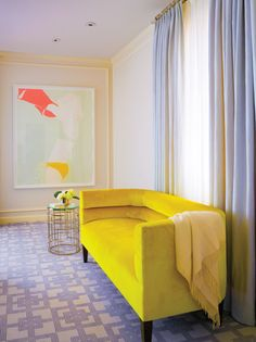 Weiss adds her signature pops of color to the master bedroom, including art by Natasha Law and a bright lemon-yellow Belmar & Co. custom-made settee, rendered in Dedar fabric.