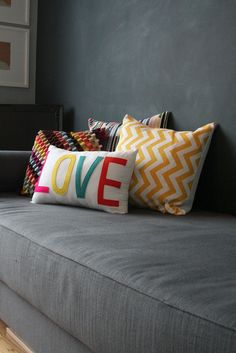 colorful pillows and grey couch!