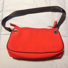 Lacoste Red Shoulder Bag Excellent condition! Authentic Lacoste Red Shoulder bag. Used only a few times. Smoke free/pet free. Lacoste Bags Shoulder Bags