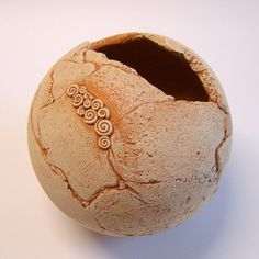 Sphere terracotta garden. TikaCeramics (on Etsy)