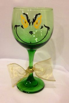 Stem wineglass decorated with the grinch . Coordinating ribbon detail is added. Can personalize, add names, etc. just message me! Shipping for this