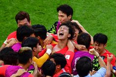 TOPSHOT South Korea's players celebrate their second goal during the Russia 2018 World Cup Group F football match between South Korea and Germany at...