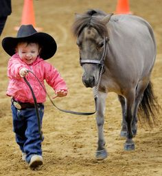 Just a young cowboy with his miniature horse!
