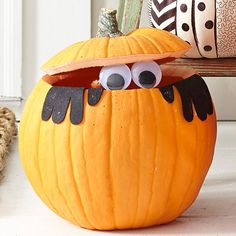 To make the design, cut along the top of your pumpkin to make a lid; set aside. Hollow out your pumpkin. Using our hand pattern, trace two hands onto black felt and cut out. Using crafts glue, attach the two hands to the pumpkin. Adhere large googly eyes in place using crafts glue