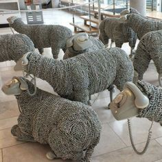 Sheep made from old phones and cords.