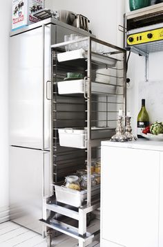 34 Insanely Smart DIY Kitchen Storage Ideas  YOU WOULD BE AMAZED AT WHAT YOU CAN USE IN A TINY SPACE THAT COMES FROM THE RESTURANT BUSINESS. EVERY SAT PAPER ADVERTISES A SALE O JUST THAT, AN INDUSTRIAL KITCHEN..SOLD BY PEICE USUALLY, GREAT BARGAINS ON UNEXPECTED STORAGE ITEMS SUCH AS THIS