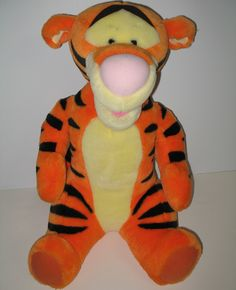 "TIGGER talks and is soooo cute. Give hime a hug and he'll say, ""I'm Tigger,"" ""You're the Best,"" ""You're Squeezing my Suffin',"" ""I feel like bouncin',"" or ""Tiggers Love Hugs.""  #winniethepooh #plush #tigger #ck"