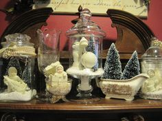 Sunday View- snow babies, vintage jewelry, and vintage glassware make a nice wintery display