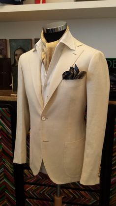 Sartoria Dalcuore. so instead of the yellow ascot a orange or purple.. I am thinking orange ascot and purple shirt with the white jacket for you.