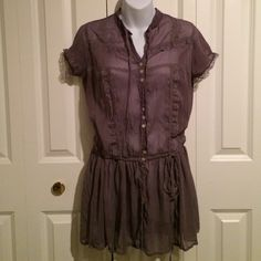 Light Plum Sheer Tunic Top with Lace This top is the epitome of feminine! The color is stunning, a light smoky plum. The material is a sheer chiffon like polyester. Lace details on front and sleeves. The shape is amazing, long bottom half is perfect over shorts or leggings. Button down. Tie cinch waist. Tie at neck in front. Tops