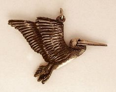 Flying Brown Pelican by McCloud9Jewelry on Etsy