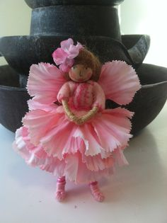 Pink flower fairy by LightofdayCreations on Etsy.