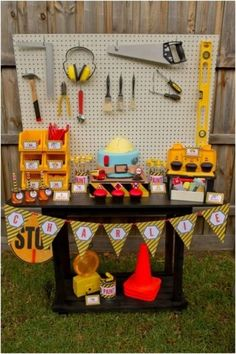 Unique Boys Construction Themed Party Ideas - love the pegboard as a party table backdrop!