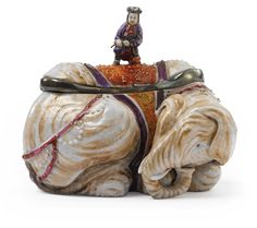 A CHINESE EXPORT FAMILLE-ROSE ELEPHANT TUREEN AND A COVER. CIRCA 1785 with a later silver-metal mount.