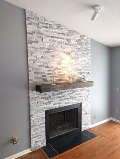 DIY Stone Fireplace Surround We are your Sacramento brick, tile, and stone specialists. Let us show you how! # fireplace and mantels, DIY Stone Fireplace Surround Stone Fireplace Surround, Stacked Stone Fireplaces, Painted Brick Fireplaces, Fireplace Redo, Fireplace Remodel, Living Room With Fireplace, Fireplace Design, Fireplace Mantels, Fireplace Ideas